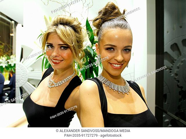 Hostesses are posing at the stand of jeweller and watchmaker Jacob & Co at Baselworld 2014 in Basel, Switzerland on Saturday, 29.03