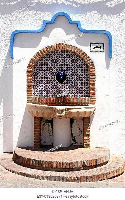beautiful decorated spanish street fountain