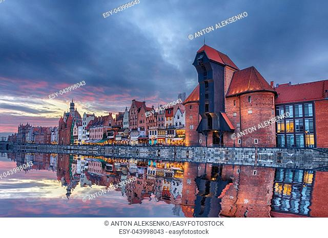Gdansk beautiful sunset, view on Zuraw port crane and medieval facades, Poland
