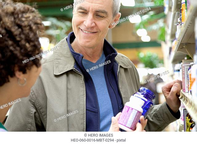 man having discussion with pharmacist
