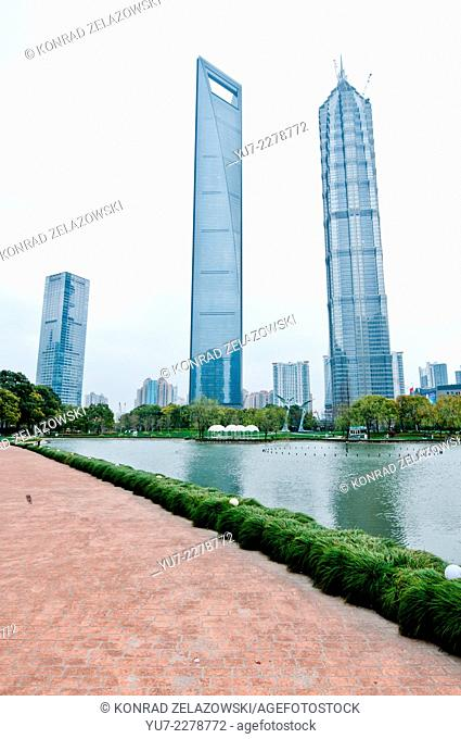 famous skyscrapers - 21st Century Tower, Shanghai World Financial Center and Jin Mao Tower in Lujiazui Finance and Trade Zone in Pudong District, Shanghai