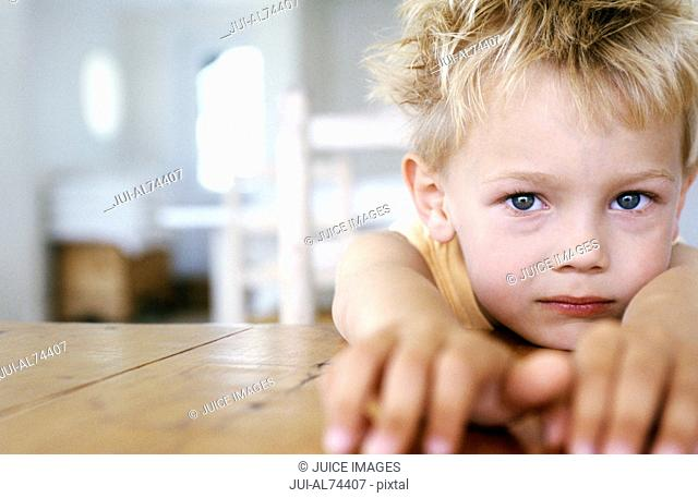 Portrait of a little boy pointing at the camera