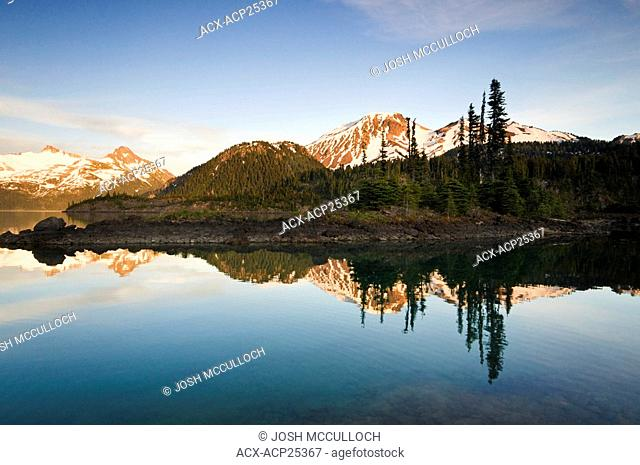 Mount Price and Clinker Peak right and the Sphinx Glacier left at sunset provide a beautiful backdrop to Garibaldi Lake and the Battleship Islands in Garibaldi...