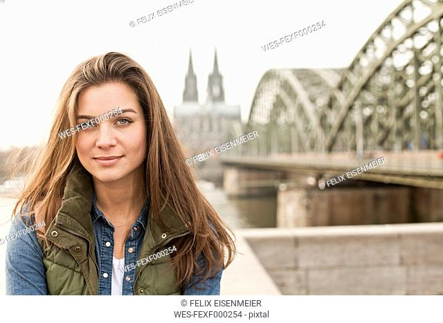 Germany, Cologne, portrait of smiling young woman