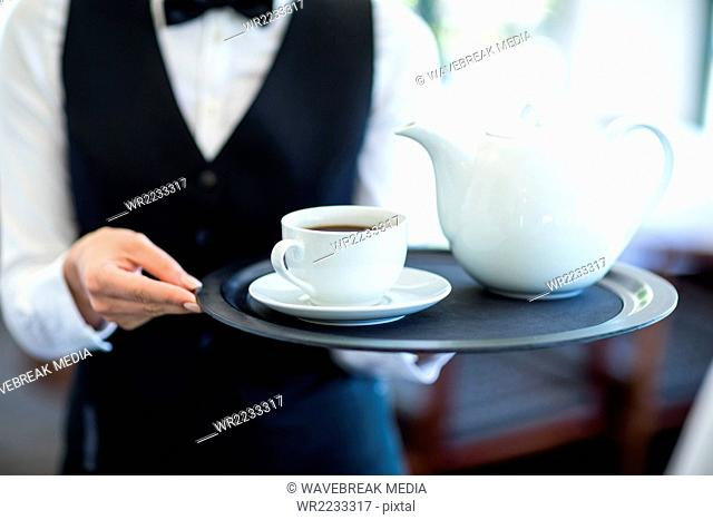 Waitress with tray of tea