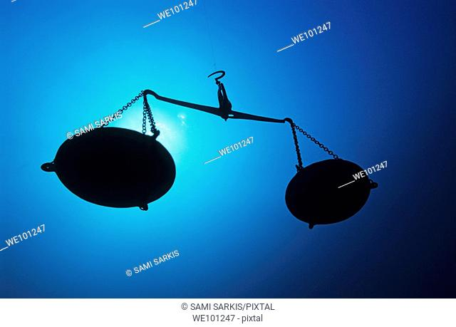 Silhouette of a pair of scales underwater
