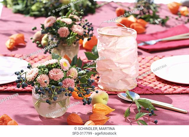 Table decoration of asters, Boston ivy & Chinese lanterns
