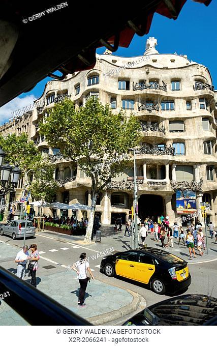 Street scene with Gaudi designed building, Barcelona, Spain