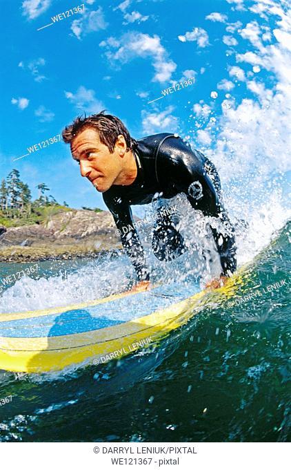 Male surfer, aged 25-30  Tofino  British Columbia  Canada