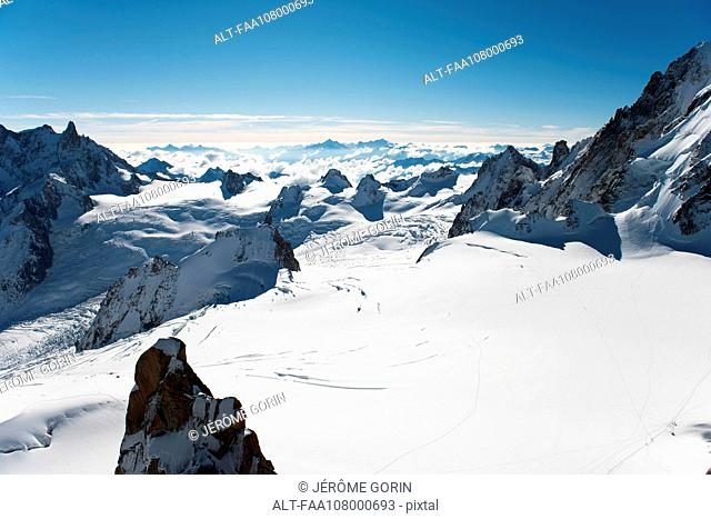 Scenic view of snow-capped mountain peaks