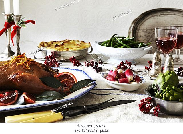 Holiday dinner table with poultry and vegetables