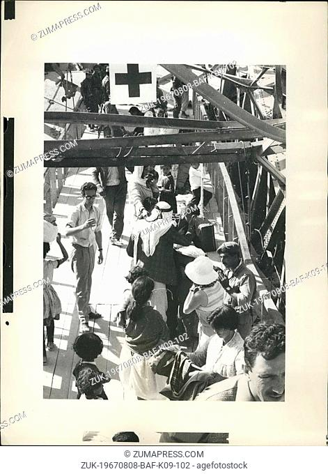 Aug. 08, 1967 - Refugees cross the Jordan. : About 350 refugees, many carrying bundles and suitcases, on Friday (Aug18) crossed back over the Jordan to return...