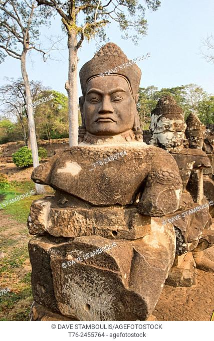 Giant stone head at the South Gate of Angkor Thom at Angkor Wat in Siem Reap, Cambodia