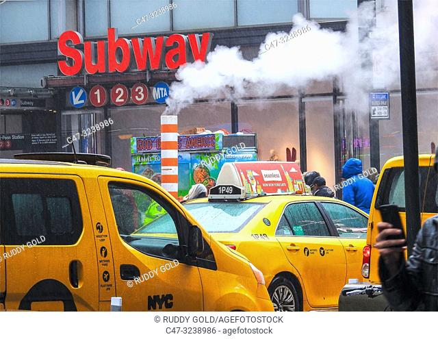 New York. Subway station for the 1, 2 and 3 lines. Midtown at 34th street and 7th Avenue on a cloudy, cold, rainy day