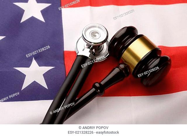 Wooden Gavel And Stethoscope On Usa Flag