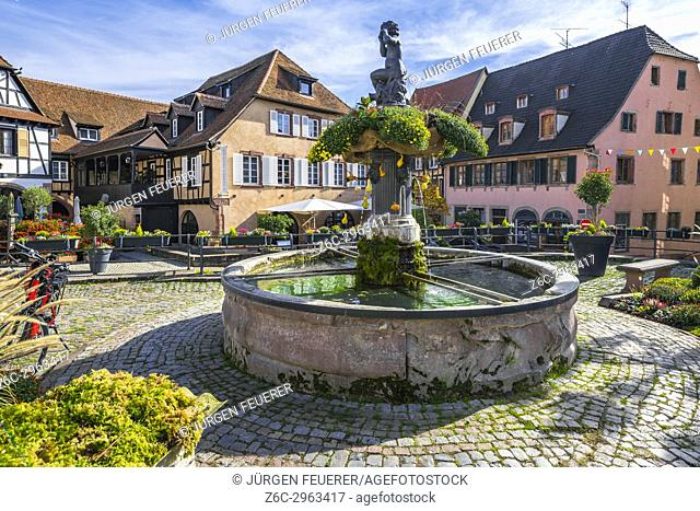 fountain and old houses in the centre of the village Barr, on the Wine Route of Alsace, France
