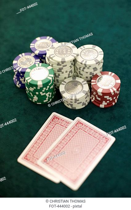 Two playing cards and piles of gambling chips on a table, Las Vegas, Nevada