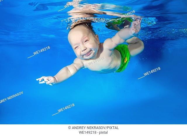 37605c65fd1de Legs of boy in a swimming pool, Stock Photo, Picture And Royalty ...