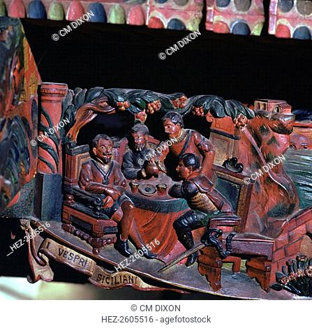 Depiction of the Sicilian Vespers: Sicilians rise against their French masters on Easter Monday 1282 in Palermo, on a traditional Sicilian painted cart in...