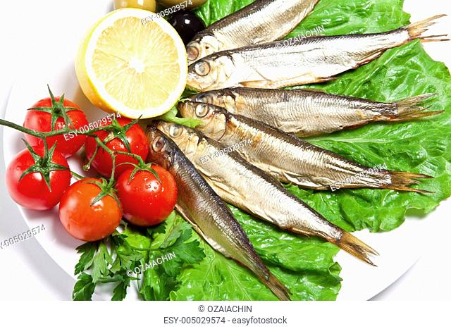 smoked fish served with tomato fennel and lemon