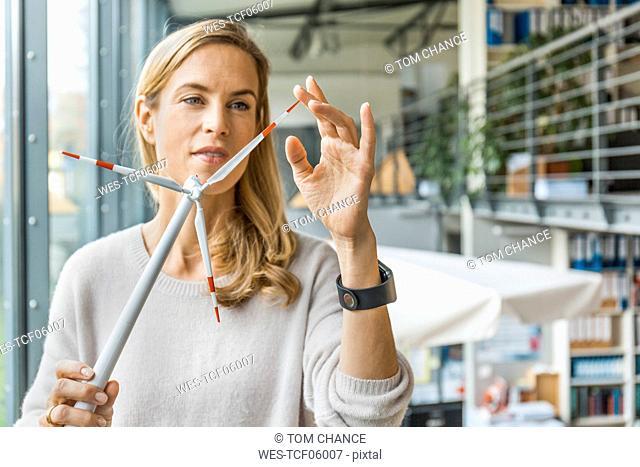 Woman in office working on wind turbine model