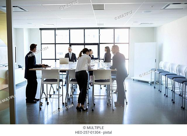 Business people standing in conference room meeting