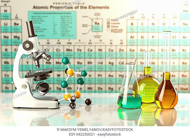 Test glass flasks and tubes with colored solutions on the periodic table of elements. Laboratory glassware. Science chemistry and research concept