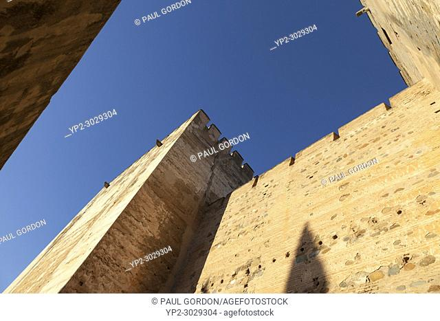 Granada, Spain: The Alhambra Palace and Fortress. Plaza de Armas at the Alcazaba fortress. The two towers, Torre del Homenaje and Torre Quebrada