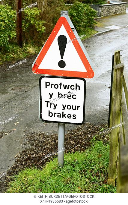 Bilingual sign in Welsh and English warning drivers to try your brakes after fording a river, Llanrhystud, Wales