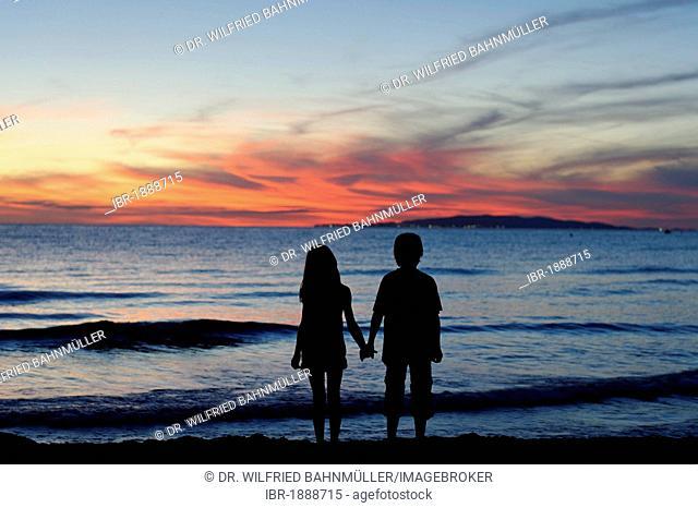 Couple, silhouetted at sunset, beach, near Punta Ala, Mediterranean Sea, Tuscany, Italy, Europe