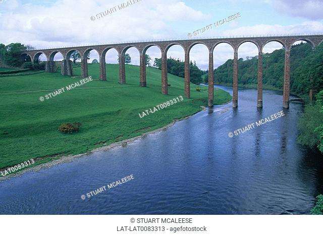 Railway viaduct. High bridge/ thin pillar supports. Stretching over river. Near Roman camp Trimontium