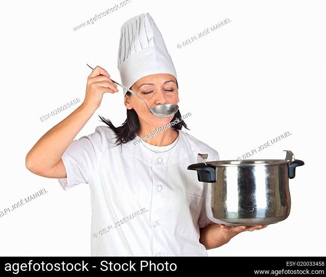 Pretty cook girl testing a meal