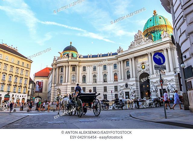 Vienna, Austria - 19 August, 2018: Tourists in the carriage near Hofburg
