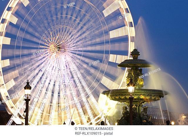 Ferris wheel and fountain on the Place de la Concorde, Paris, France