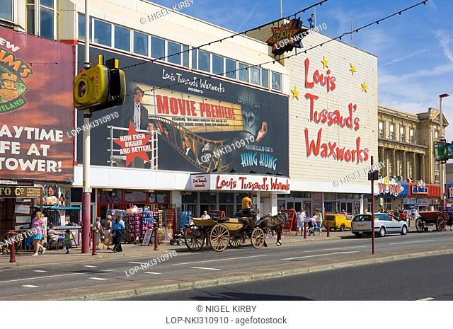 England, Lancashire, Blackpool, Horse and carriage outside Louis Tussauds Waxworks on the Golden Mile in Blackpool