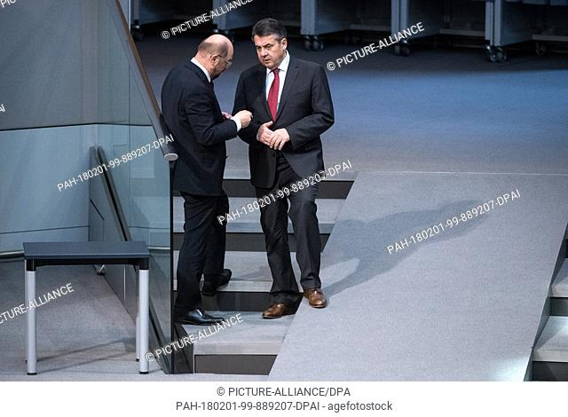 Foreign minister Sigmar Gabriel (R, Social Democratic Party) and Martin Schulz, chairman of the SPD speak during a plenary meeting at the German Bundestag in...
