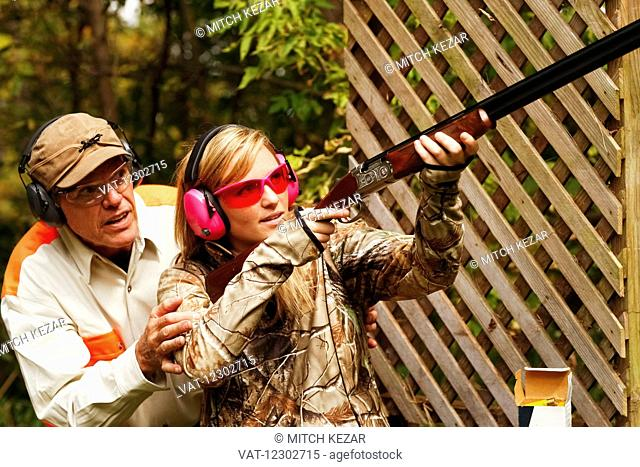 Father and Daughter At A Shooting Range