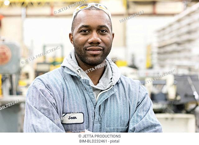 Smiling worker in factory