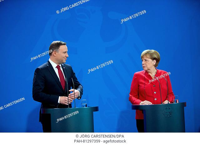 German chancellor Angela Merkel (CDU) and Polish president Andrzej Duda speak at a press conference on the occasion of the 25th anniversary of the German-Polish...