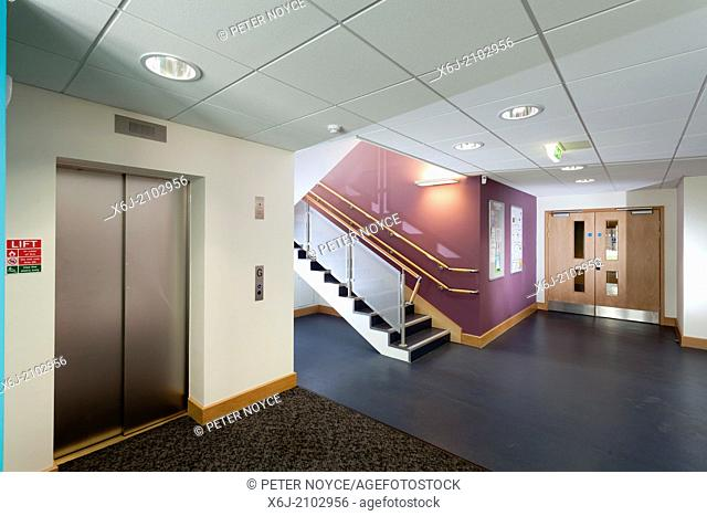 Modern office lift and stairs corridor