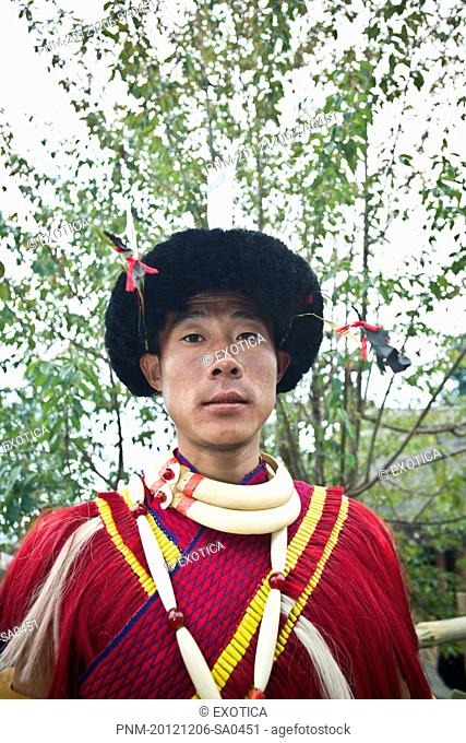 Portrait of a Naga tribal man in traditional outfit, Hornbill Festival, Kohima, Nagaland, India