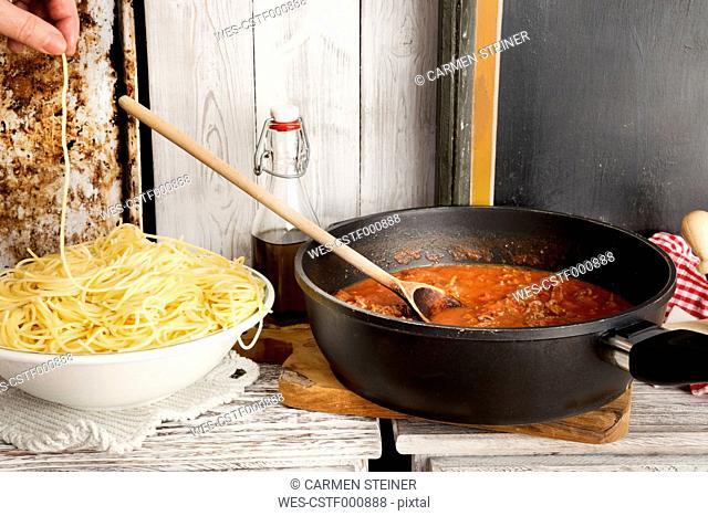 Spaghetti Bolognese, Spaghetti on plate and sauce Bolognese in pan, Spaghetti nibbling