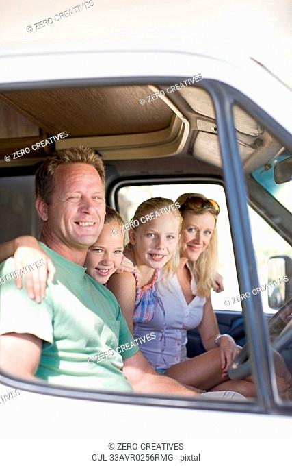 Family smiling together in RV