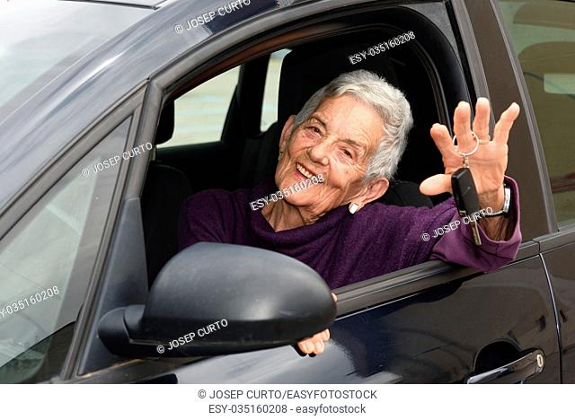 senior woman with keys of the car