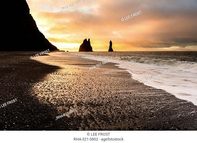 Rock stacks of Reynisdrangar at sunrise, from Halsanefs Hellir Beach near Vik, South Iceland, Polar Regions