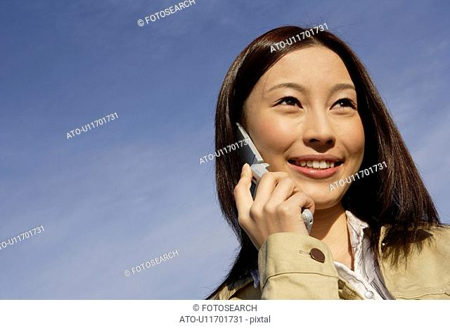 View of young woman using cellphone