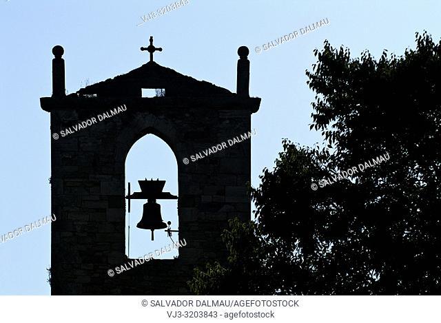 silhouette steeple st. maria de porqueres,12th century,girona,catalonia,spain,