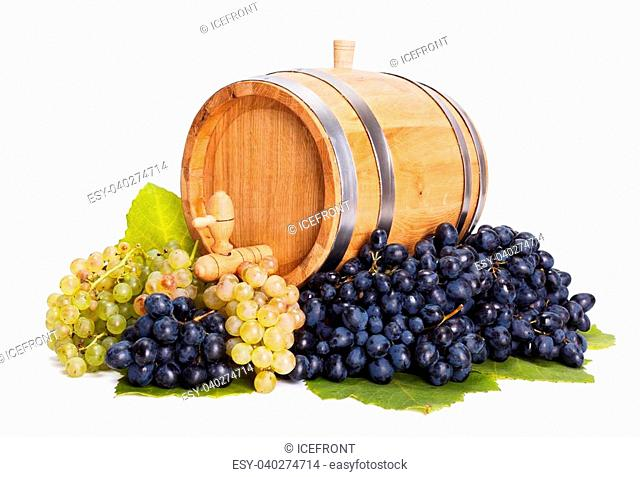 Small oak barrel in a bunch of blue and white grapes