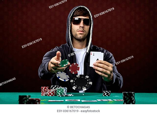 Poker player, on a red background, throwing poker chips