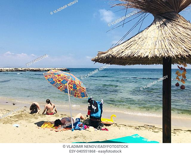 Pomorie, Bulgaria - View of the people spending time on the beach